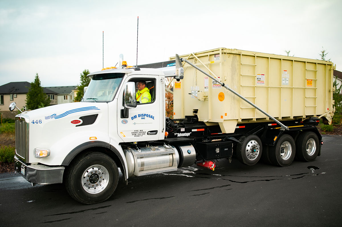 Photo of DM Recycling truck unloading a secure storage unit.